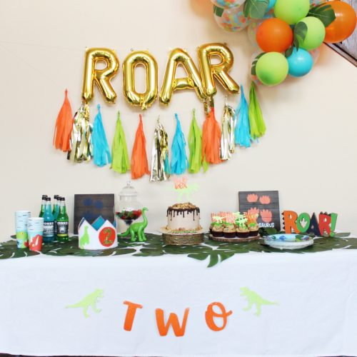 blue green and orange balloon arch tassel banner roar balloon arch dinosaur themed birthday decor