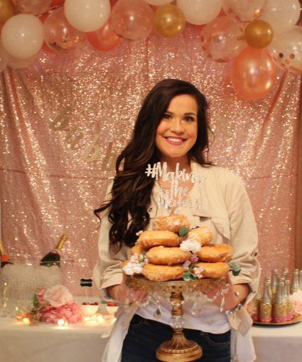 Donut cake on rhinestone cake stand glitter cake topper floral details blush bridal shower glitter backdrop mimosa bar