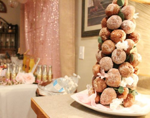 domed donut tower with donut holes and floral decorations
