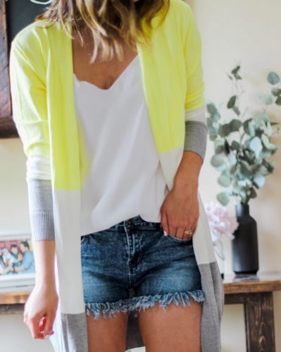 yellow gray and white amazon cardigan with denim cutoff shorts and white camisole