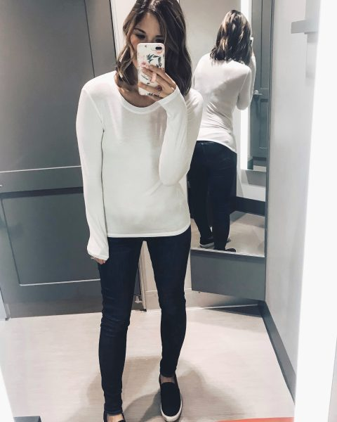 white long sleeve tee with skinny jeans and black slip on sneakers
