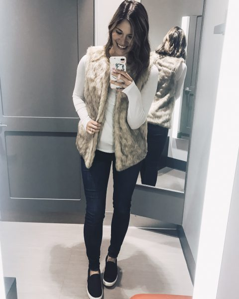faux fur vest of white long sleeve tee with skinny jeans and black slip on sneakers