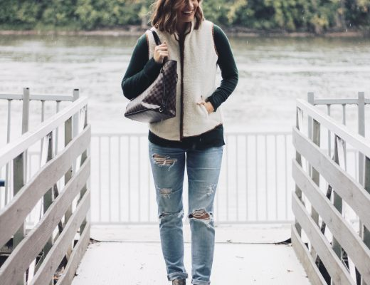 sherpa vest-green sweater-tomgirl jeans-checkered bag