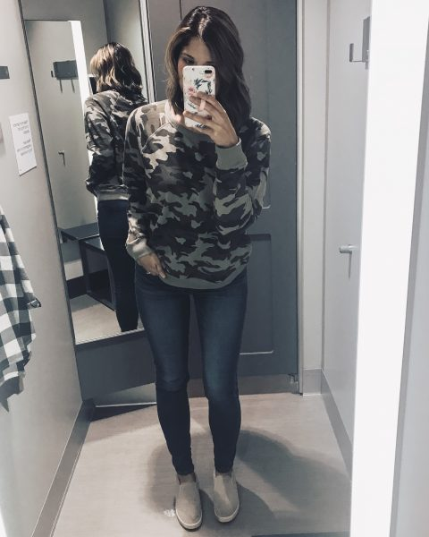 camouflage sweatshirt with skinny jeans and slip on sneakers