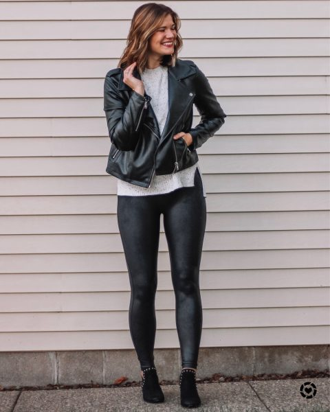black faux leather moto jacket white speckled crew neck sweater spanx faux leather leggings black studded sam edelman booties