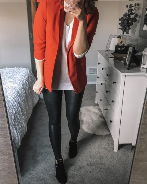 red boyfriend blazer / white v neck soft sweater / spanx faux leather leggings / black studded faux suede booties