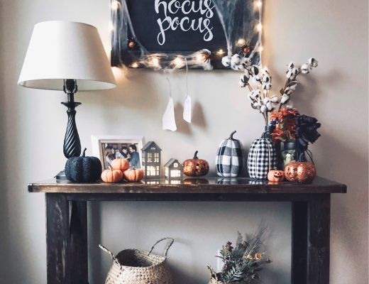 halloween inspired entryway table with hocus pocus chalkboard spiderwebs buffalo plaid pumpkins wicker collapsible storage baskets faux cotton stems twinkle lights
