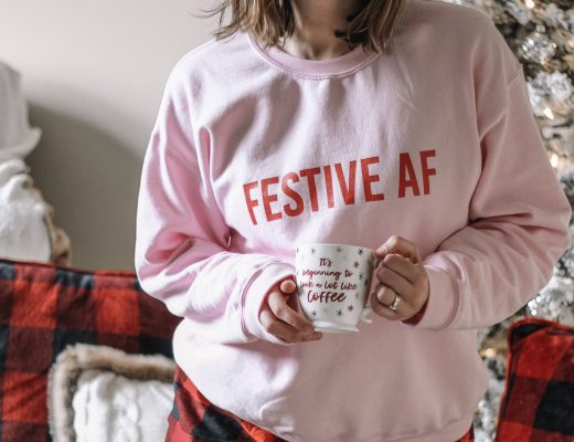 pink festive AF sweatshirt red pom beanie flannel buffalo plaid shorts flocked christmas tree buffalo plaid pillows