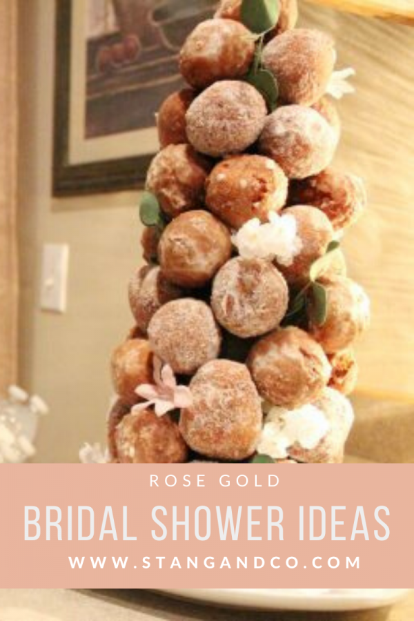 elegant and feminine donut hole cake tower with pink and ivory floral accents rose gold bridal shower