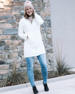white puffer jacket pastel pom beanie hat from gap black studded booties