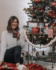 cozy coffee and hot chocolate bar cart next to tree with red and green decor