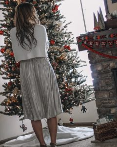 white cropped eyelash sweater bow sleeves champagne midi skirt hair extensions suede booties christmas tree photos christmas garland