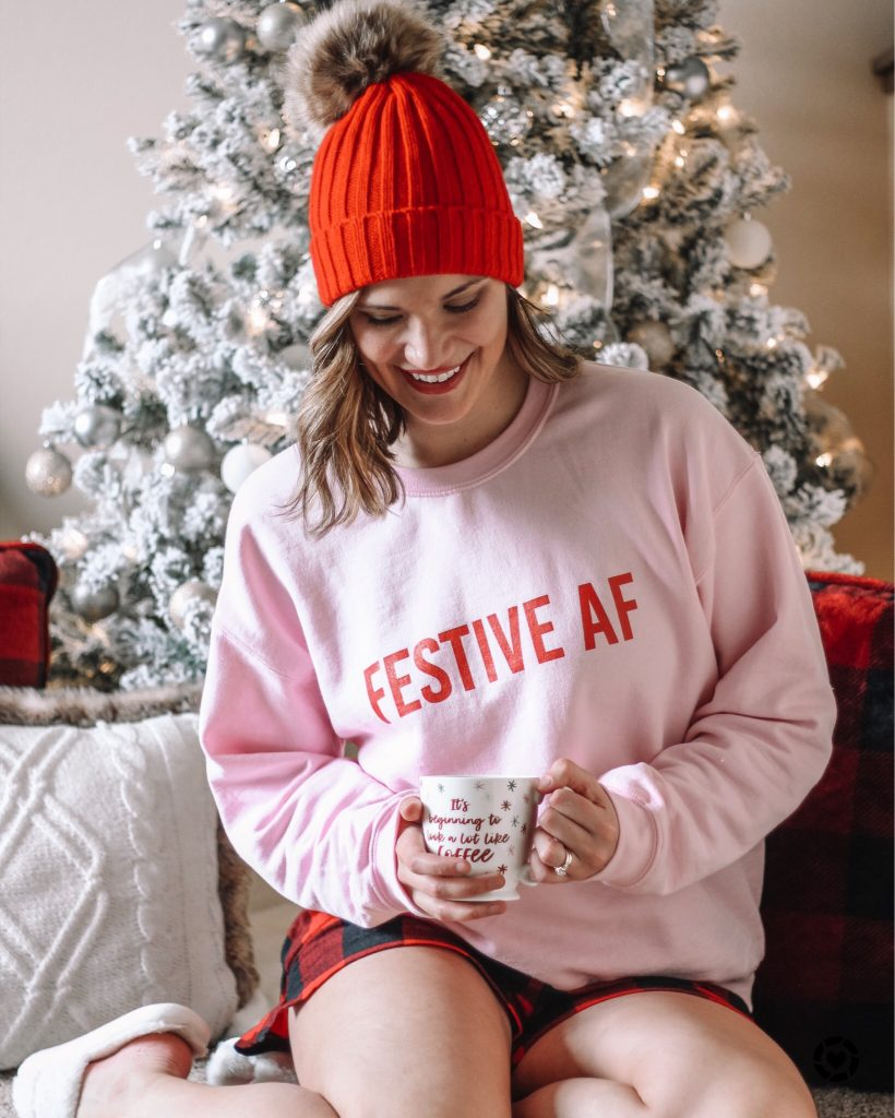 festive af pink and red sweatshirt red pom beanie holiday style inspo