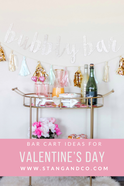bubbly bar mimosa bar pink and gold bar cart bubbly bar glitter banner galentines day ideas