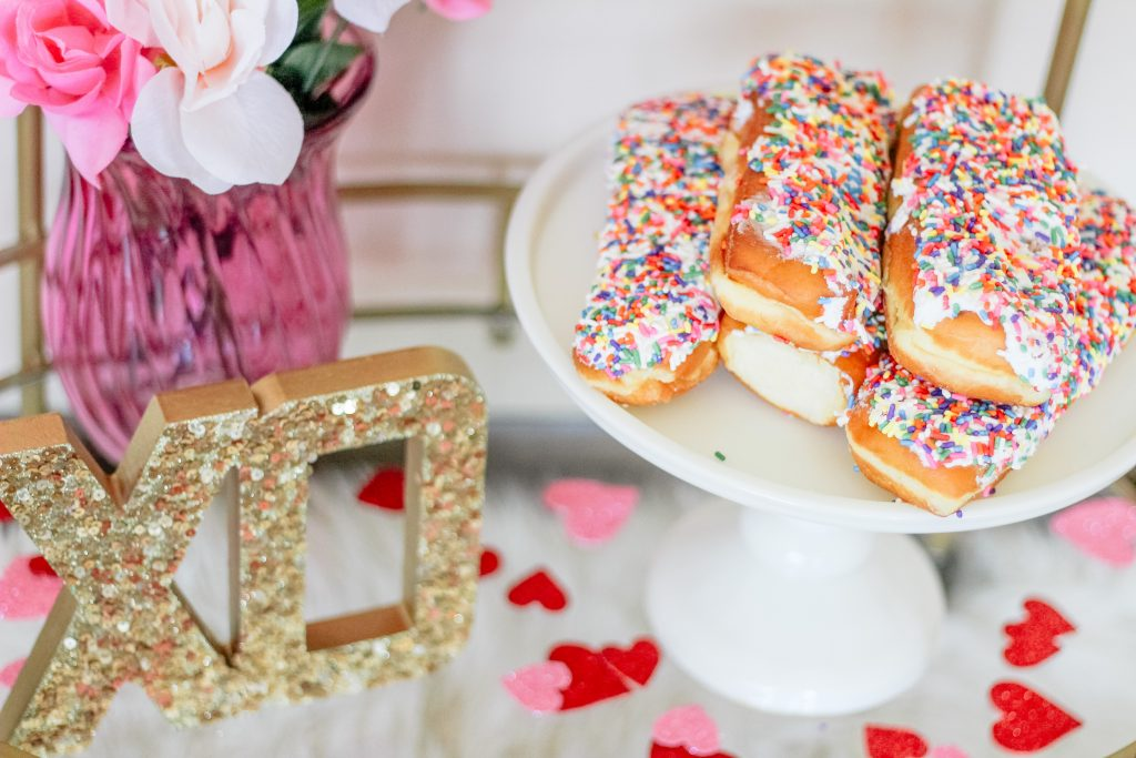 sprinkle donuts on cake stand gold sequin xo decoration pink flower vase glitter heart confetti