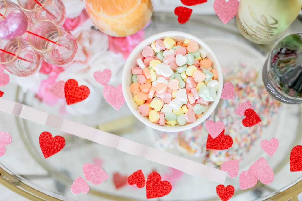 valentines day confetti heart confetti candy hearts in white latte bowl stemless champagne flutes mimosa bar bubbly bar
