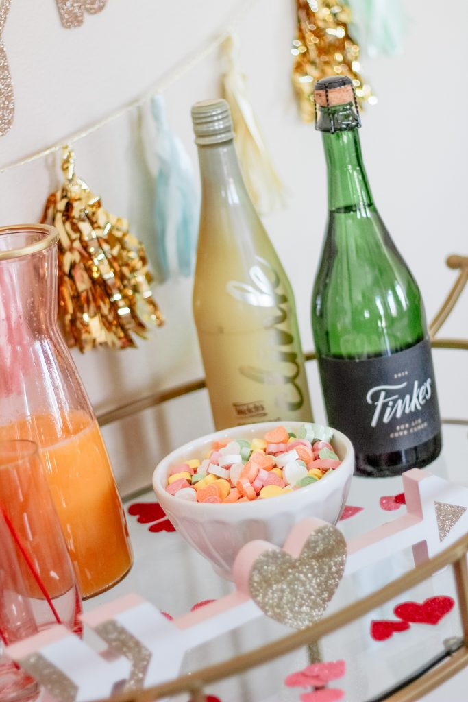 champange bar bubbly bar pink and gold drink cart bar cart styling tips