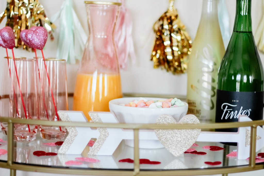 blush champagne flutes and juice carafe pink and gold mimosa bar blush bubbly bar