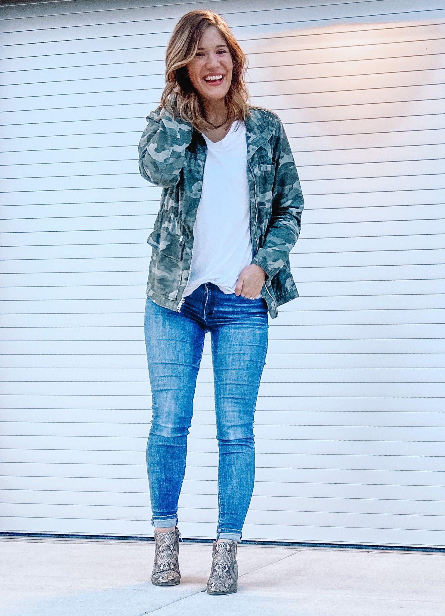 camo utility jacket snakeskin booties white v neck t shirt dark wash jeans