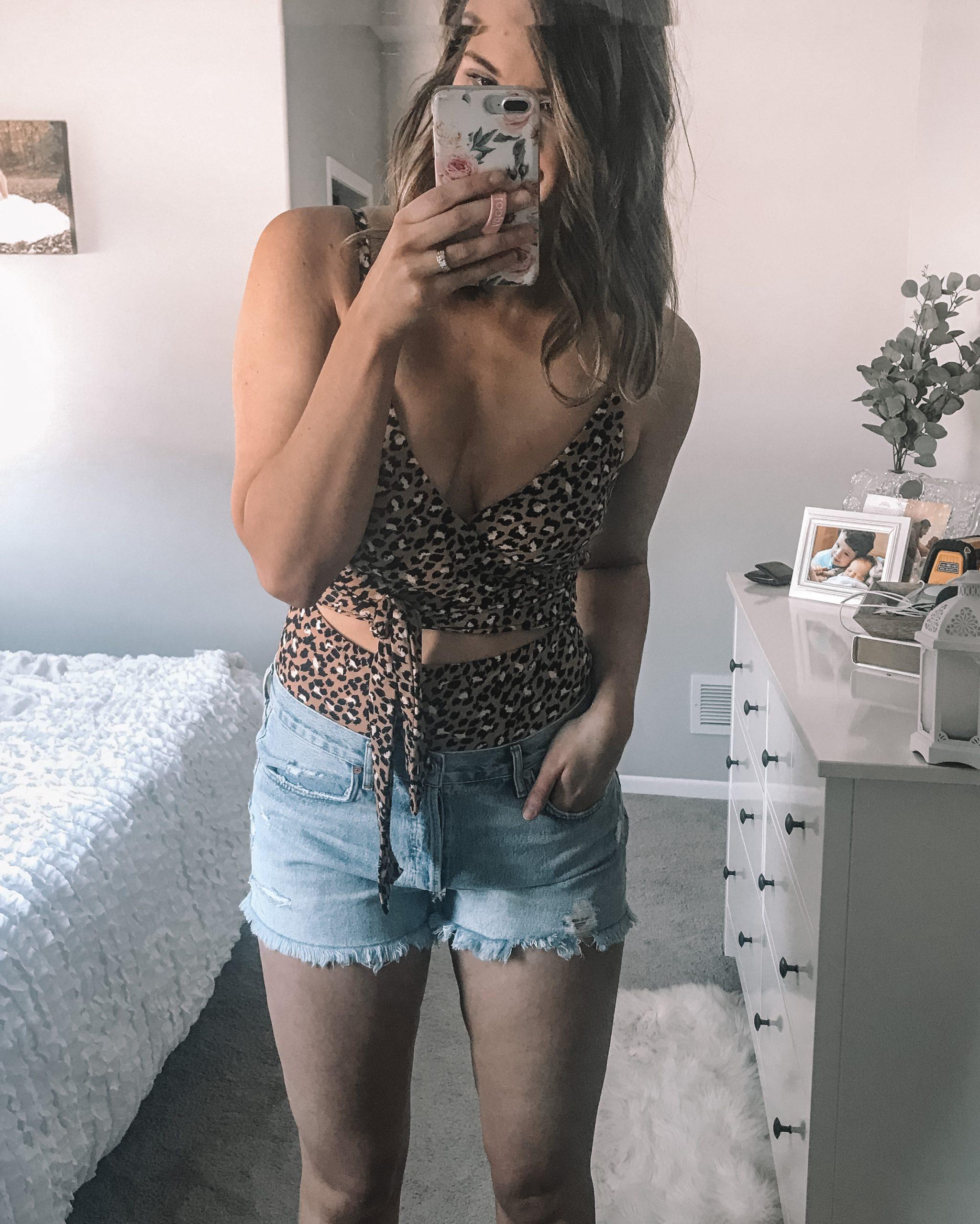 Cheetah print wrap one piece swimsuit in long sizing agolde parker denim shorts kersha rhinestone slide sandals