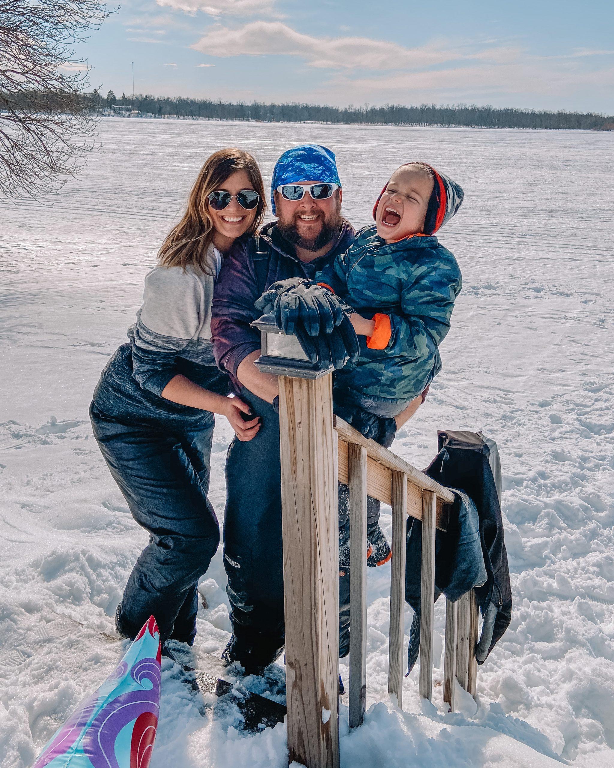 family sledding at the lake