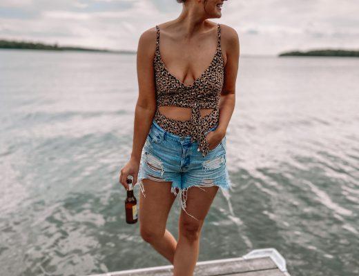 aerie cheetah wrap swimsuit / american eagle 90s boyfriend shorts / quay high key sunglasses