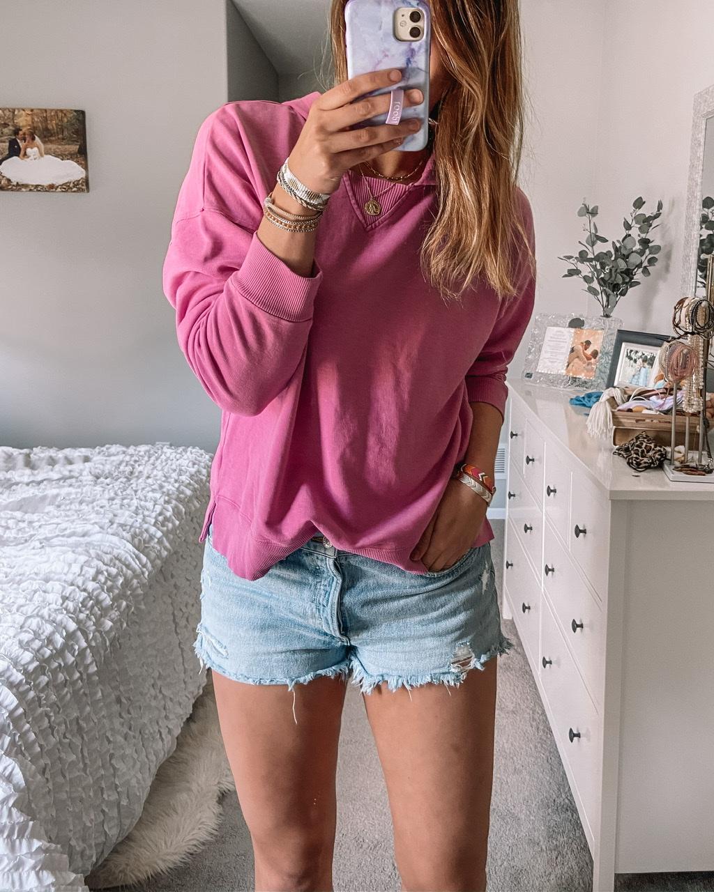 pink beach fleece sweatshirt universal threads target sweatshirt agolde parker light wash jean shorts layered gold necklace crystal cuff bracelet