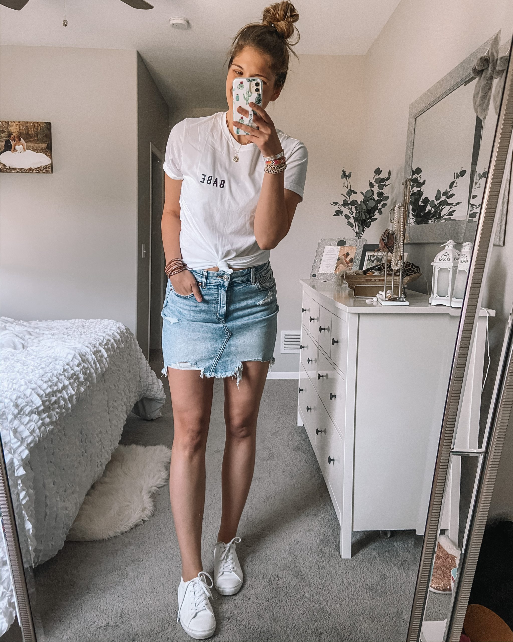 white babe tee jean skirt white tennis shoes wrap bracelets