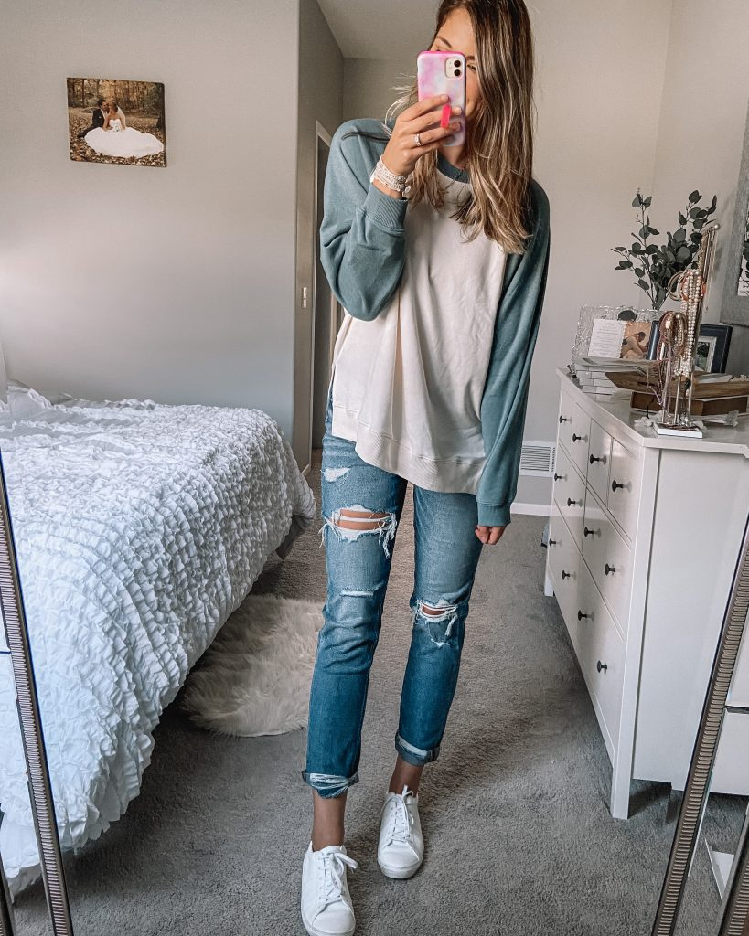 green and white baseball sweatshirt // tomgirl stretch distressed jeans / white faux leather tennis shoes