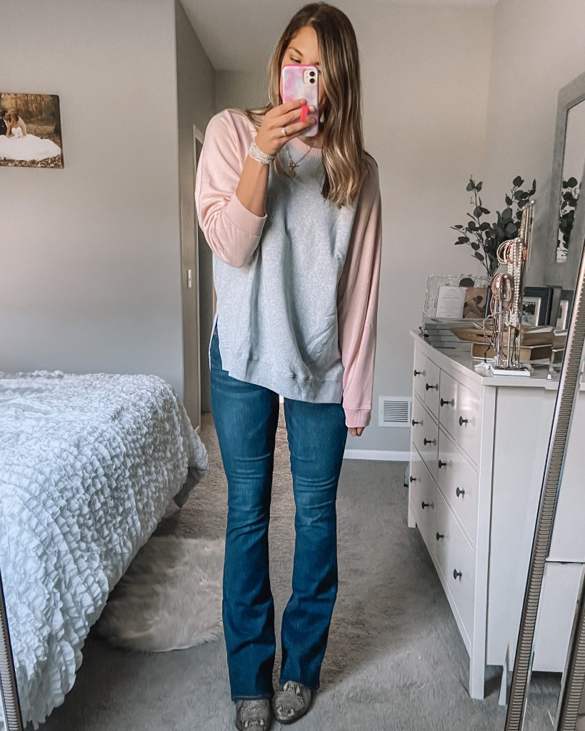 pink and gray baseball sweatshirt // dark wash extra long flare jeans // gold coin necklace // snakeskin booties // crystal wrap bracelet