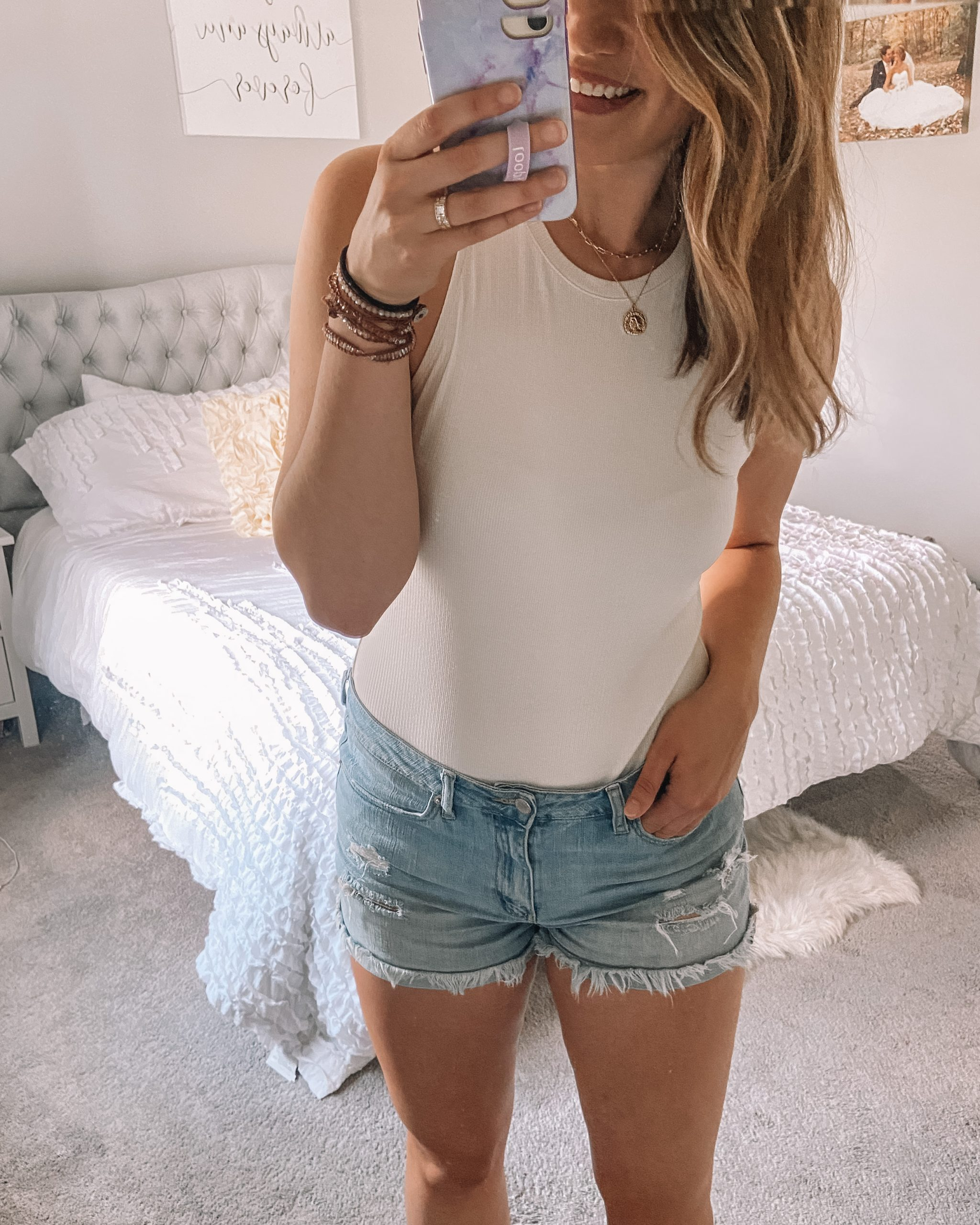 tall white bodysuit with agolde parker denim shorts