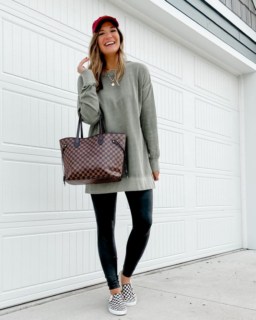 green tunic sweathsirt with spanx faux leather leggings and vans asher slip on shoes