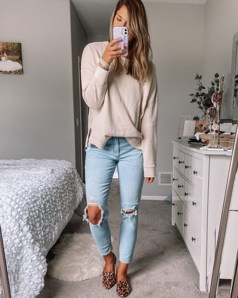 beige $11 walmart sweatshirt / distressed light wash long abercrombie jeans / cheetah print loafers