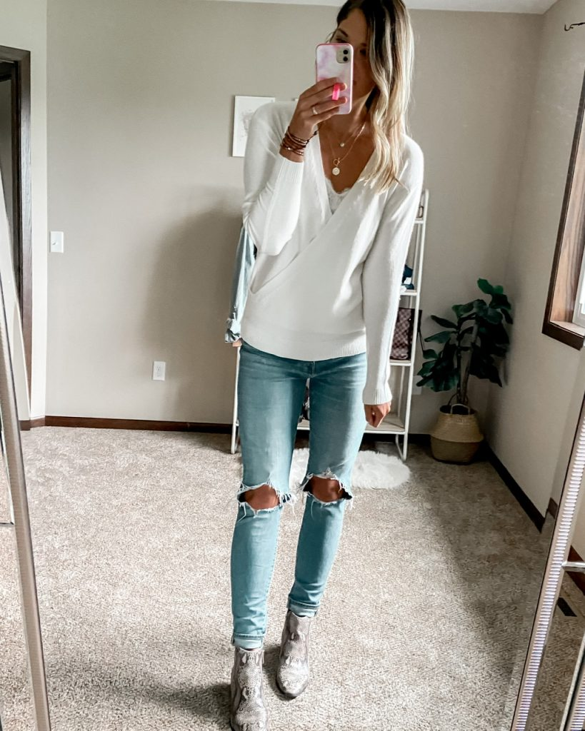white wrap front sweater / ivory wrap sweater /. busted knee jeans / snakeskin booties