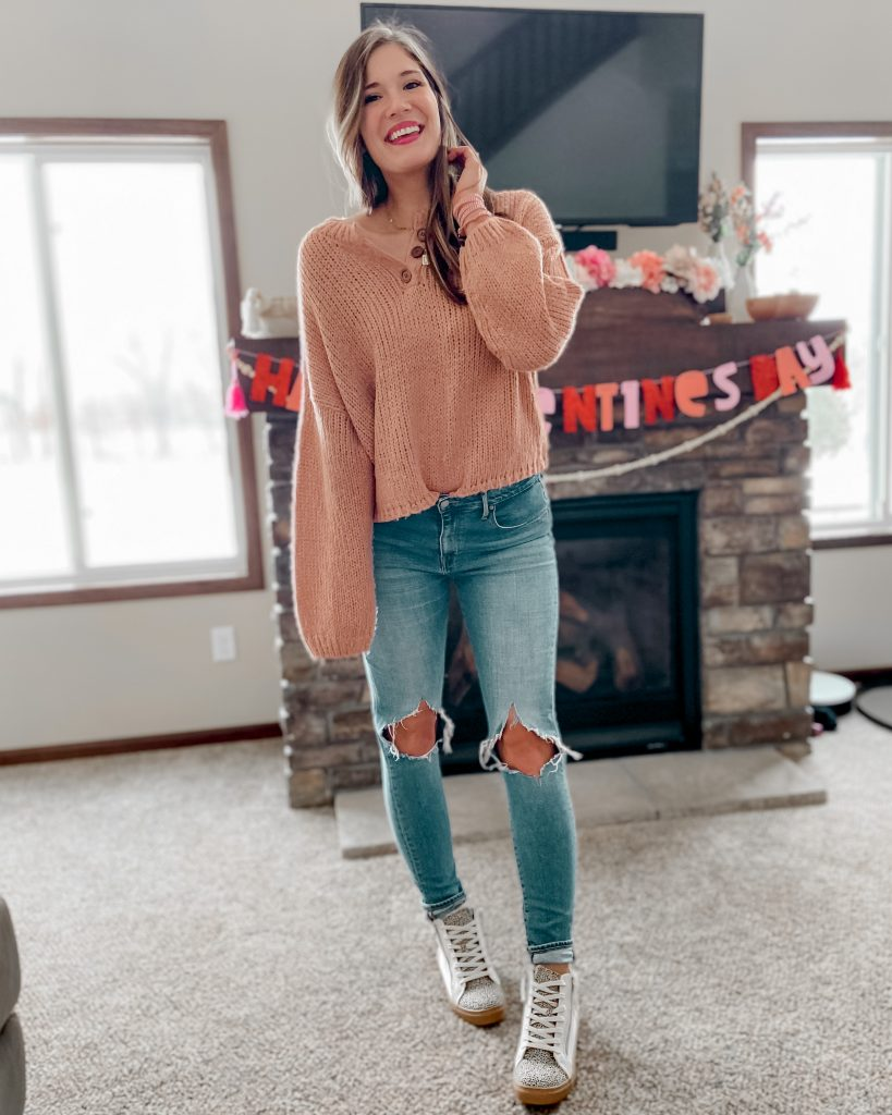 Blush henley button sweater / busted knee medium wash skinny jeans / high top cheetah print tennis shoes / Valentine's Day outfits / Valentine's Day decor / date night outfit