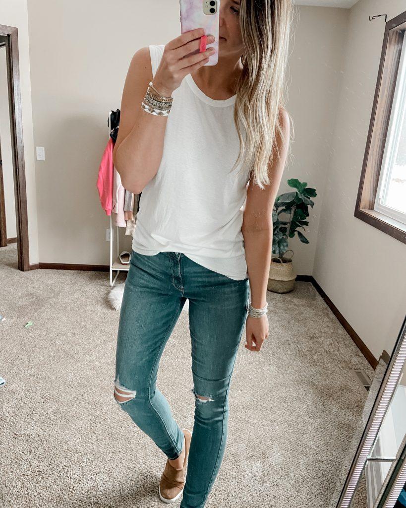 white amazon tank / crewneck neck tank / white tank top / long jeans / long skinny jeans / tan slip on shoes / cuff bracelet / crystal bracelet
