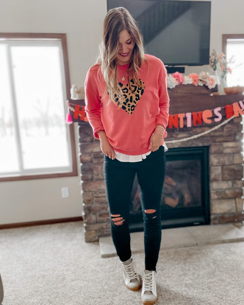 Hot pink cheetah heart sweatshirt under $20 / white layering tank black distressed long skinny jeans high top print tennis shoes Valentine's Day outfits decor date night outfit