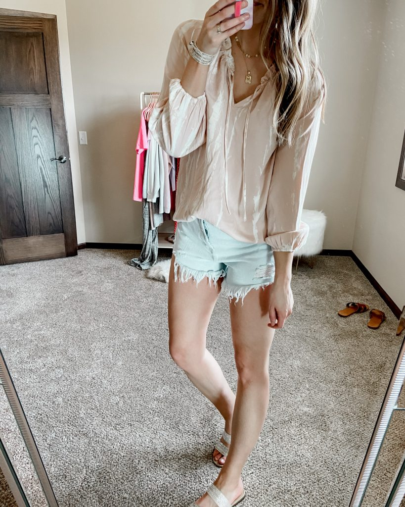 blush and white tie dye long sleeve blouse with $15 wild fable jean shorts and brown sandals | gold amazon pendant initial necklace