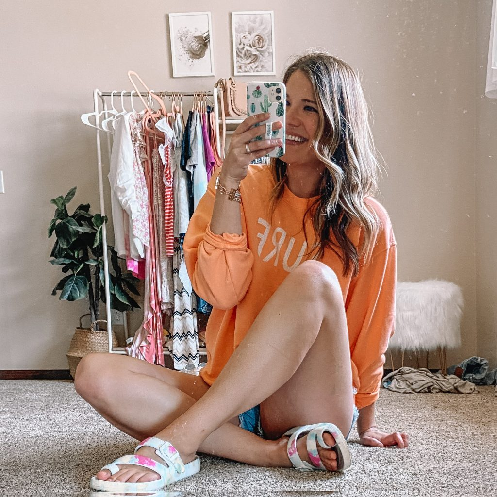 orange surf sweatshirt / neon wild fable sweatshirt / tie dye footbed sandals / waterproof sandals / jean shorts / amazon levis shorts